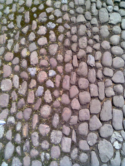 On the left are cobbles before the SWEEPRITE treatment and on the right, after the SWEEPRITE treatment